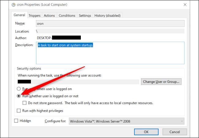 """Una ventana de propiedades de la tarea de Windows con una flecha roja que apunta a la opción """"Ejecutar, ya sea que el usuario haya iniciado sesión o no""""."""